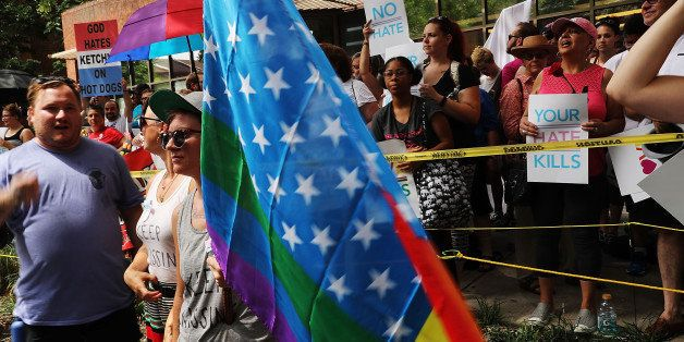 PHILADELPHIA, PA - JULY 26:  Over 1,000 people gather outside of a LGBT center in downtown Philadelphia to protect it from  W