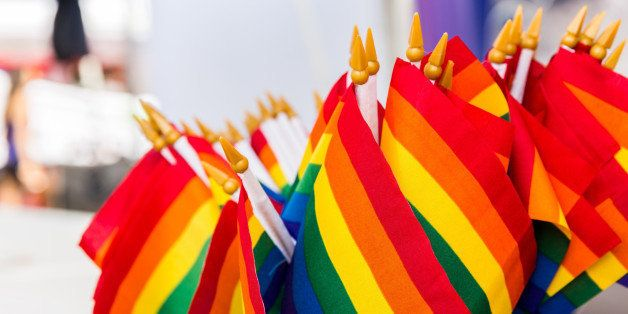 Small gay pride flags are awaiting sale.