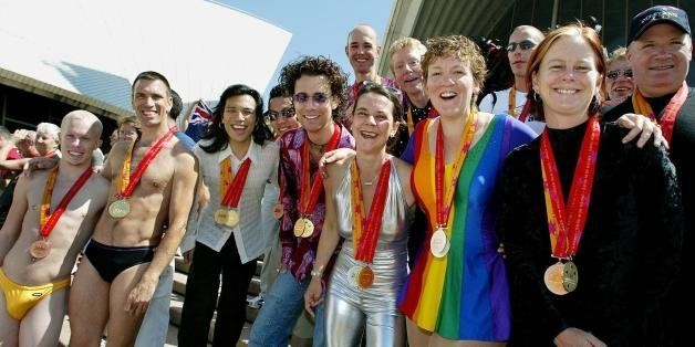 SYDNEY, AUSTRALIA:  Medal winners from the 2002 Gay Games, gather on the steps of the Sydney Opera House 08 November 2002, fo