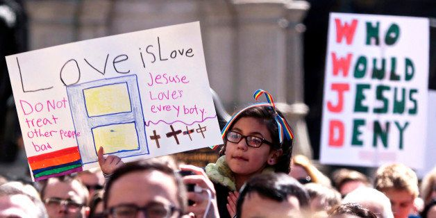 Demonstrators gather at Monument Circle to protest a controversial religious freedom bill recently signed by Governor Mike Pe