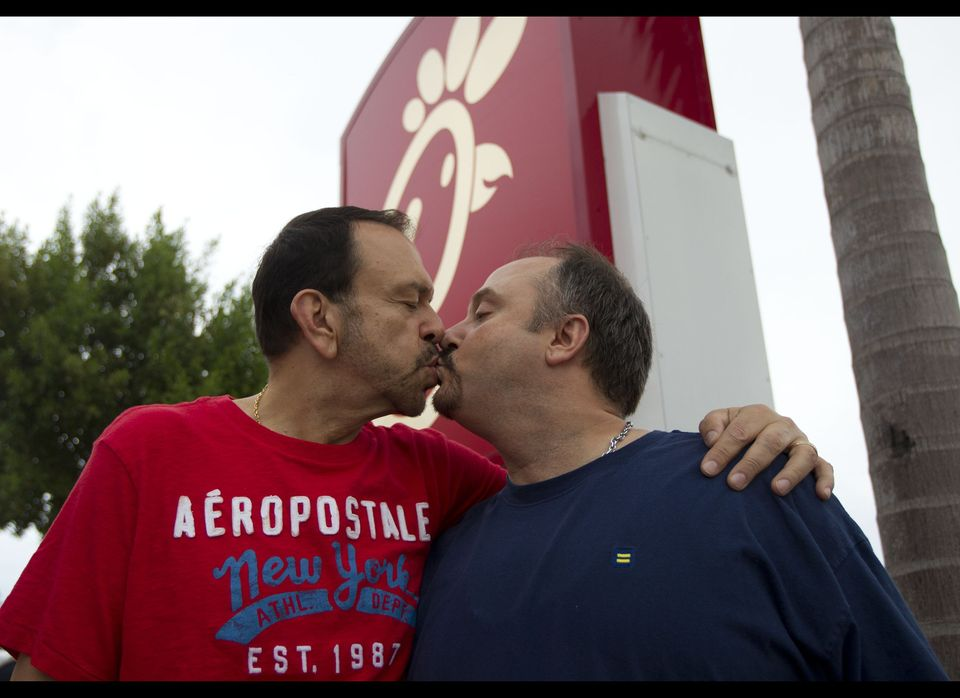 Tony Scarcellad, left, kisses his partner of 15 years, Dan Zegelien during the protest of a Chick-fil-A restaurant in Pompano