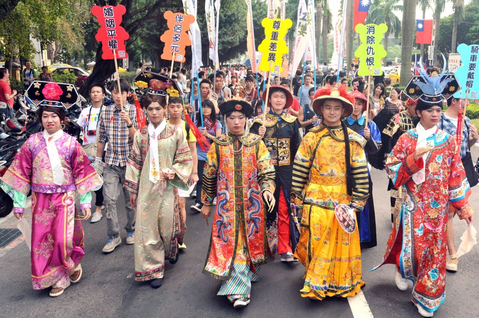 Participants take part in the gay parade in Taipei on October 27, 2012. Tens of thousands of people from Taiwan's gay communi