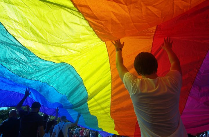 People hold up a large rainbow flag as they take part in the second gay pride festival in the Czech capital Prague on August