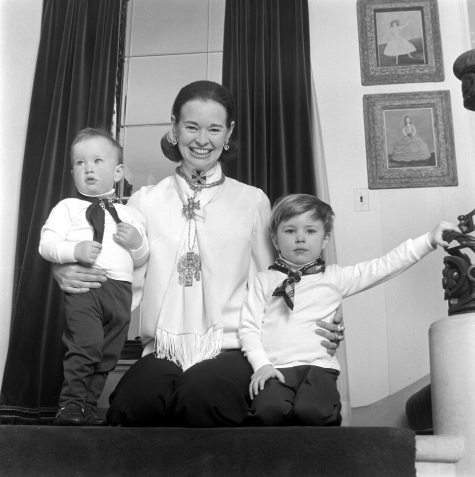 LONG ISLAND, NY - CIRCA 1969:  Socialite and heiress  Gloria Vanderbilt poses for a portrait session with her sons Anderson C