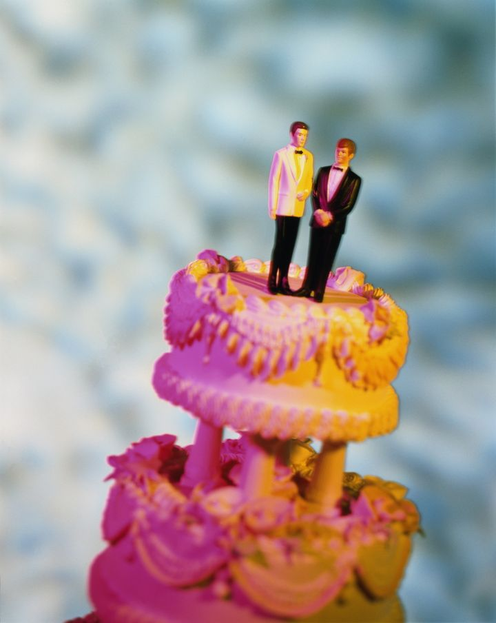 Wedding cake with two male figures  on top