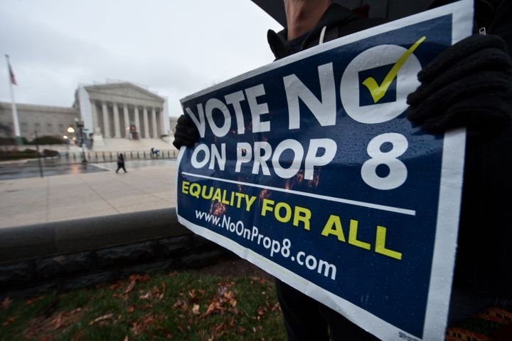 A man holds a sign against California's Proposition 8 which bans same-sex marriage in front of the US Supreme Court in Washin