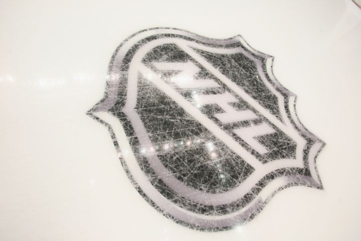 PITTSBURGH - OCTOBER 07:  New logos are etched into the ice prior to the game between the Pittsburgh Penguins and the Philade
