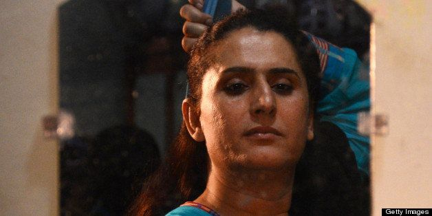 TO GO WITH Pakistan-unrest-vote-sex,FOCUS by Khurram Shahzad  This photograph taken on April 5, 2013 shows transgender Sanam