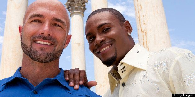 Smiling Gay Couple Looks for Support