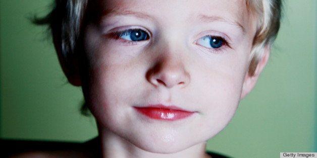 Close-up of boy wearing diamond tiara.