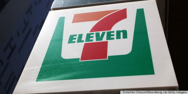 Signage for the 7-Eleven convenience-store is displayed in Tokyo, Japan, on Thursday, April 5, 2012. Seven & I Holdings Co.,