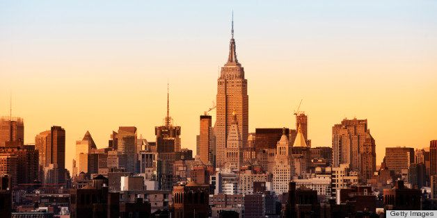 Skyline of New York with Empire State Building- see from Brooklyn bridge