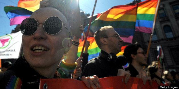 Gay rights activists march in Russia's second city of St. Petersburg May 1, 2013, during their rally against a controversial