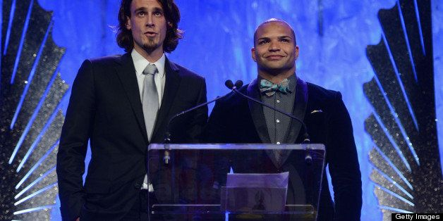 NEW YORK, NY - MARCH 16:  NFL atheletes Chris Kluwe and Brendon Ayanbadejo speak onstage at the 24th Annual GLAAD Media Award