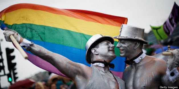 Men kiss during the HBTQ festival 'Stockholm Pride' parade on August 6, 2011 in central Stockholm.  AFP PHOTO / JONATHAN NACK