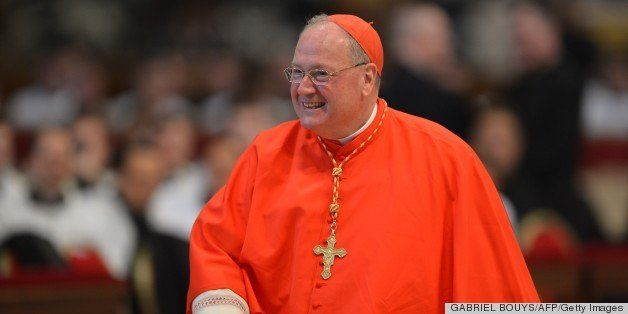 US cardinal Timothy Michael Dolan attends a mass at the St Peter's basilica before the conclave on March 12, 2013 at the Vati