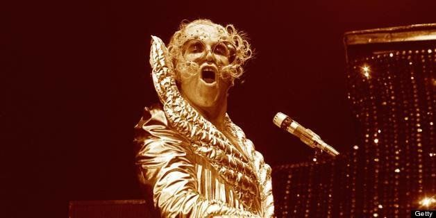 UNITED STATES - OCTOBER 01:  USA  Photo of Elton JOHN, Elton John performing on stage , shiny costume  (Photo by Robert Knigh