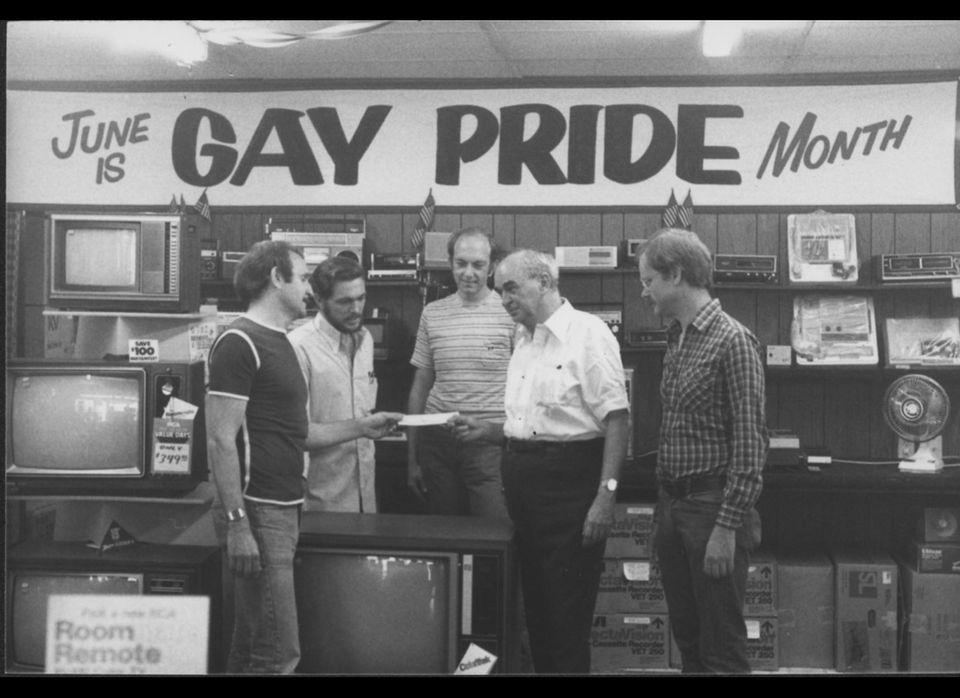 Gene Kittridge, owner of Gene's TV and longtime gay/lesbian philanthropist, contributes money to Jim Kepner (second from righ