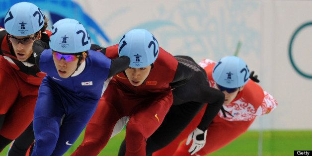 Canada's Olivier Jean (L), New Zealand's Blake Skjellerup (2nd L), Xianwei Liu of China and Russia's Ruslan Zakharov compete