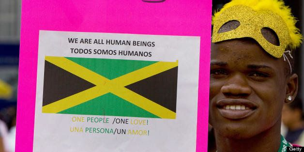 A member of Jamaica's gay community takes part in the first international march against stigma, discrimination and homophobia