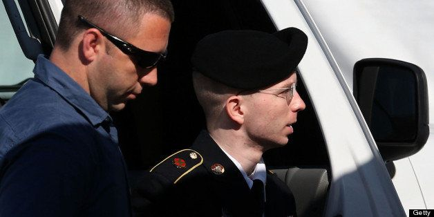 FORT MEADE, MD - JULY 30:  U.S. Army Private First Class Bradley Manning (R) is escorted by military police as arrives to hea