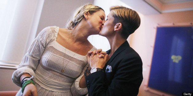NEW YORK, NY - JUNE 28:  Stefanie Berks (L) and Daisy Boyd kiss after their marriage ceremony in the east chapel at the Manha