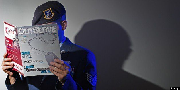 A gay member of the US Air Force who chooses to not be identified reads a copy of the new magazine 'OutServe' intended for ac