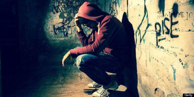 Man desperate and alone in the dark