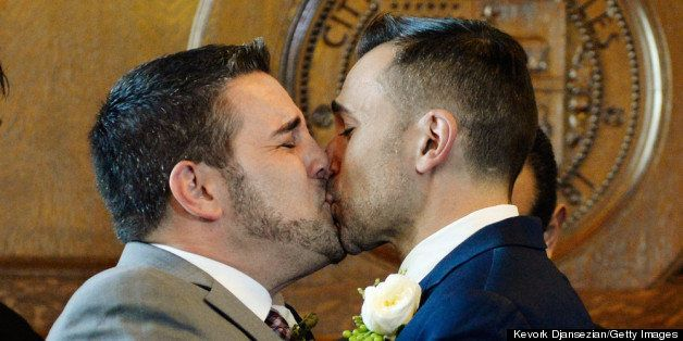 LOS ANGELES, CA - JUNE 28:  Same-sex couple Jeff Zarillo (L) and Paul Katami kiss after they were married at Los Angeles City