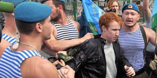Russian paratroopers scuffle with gay right activist Kirill Kalugin (C), who stood protesting against gay rights violations a