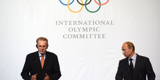 Russia's President Vladimir Putin (R) and IOC President Jacques Rogge attend an IOC executive board meeting at the SportAccor