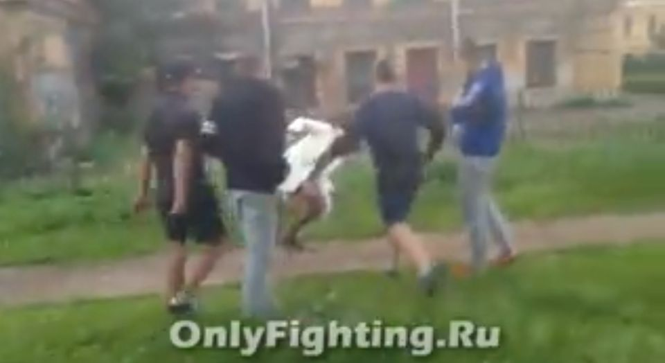 One of the men punches the victim and she falls to the ground.