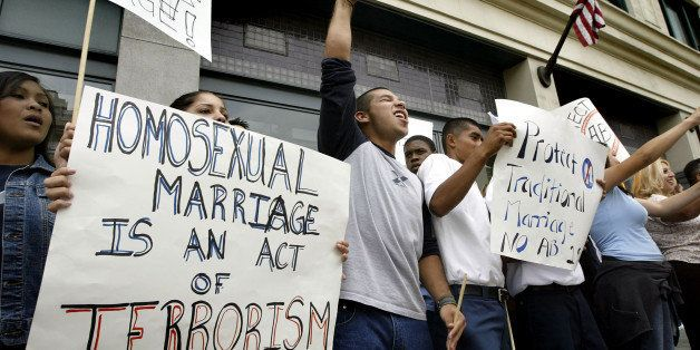 LOS ANGELES - MAY 18:  Demonstrators hold sign reading, 'homosexual marriage is an act of terrorism' as they chant slogans ag