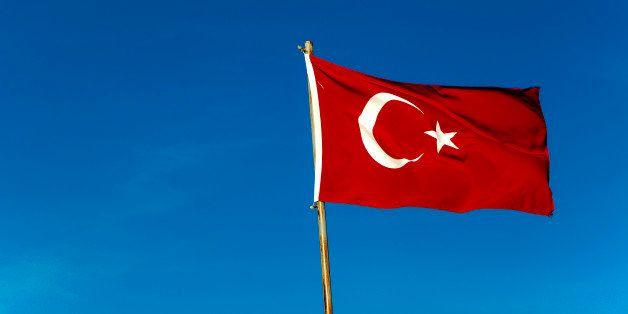 Turkish flag against blue sky