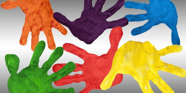 painted hands on a white and...