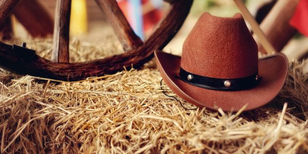 on a haystack the brown cowboy...