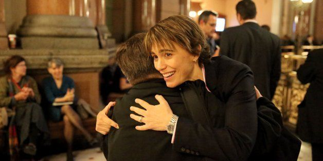Chicago Ald. Deb Mell, 33rd Ward, is hugged after the gay marriage bill cleared the House on Tuesday, November 5, 2013, in Sp
