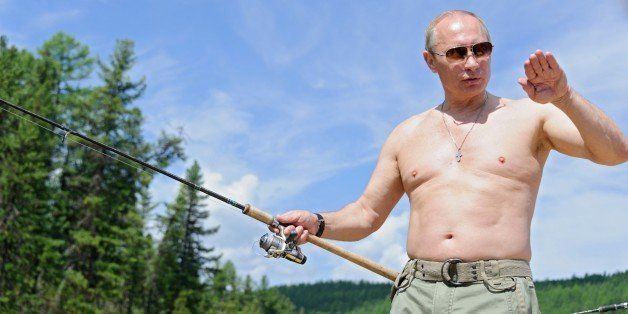This picture made available on July 26, 2013 shows Russian President Vladimir Putin fishing in the Tyva region on July 20, 20