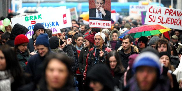 Croatian gay rights supporters hold a picture of Tomislav Karamarko, leader of the conservative opposition Croatian Democrati
