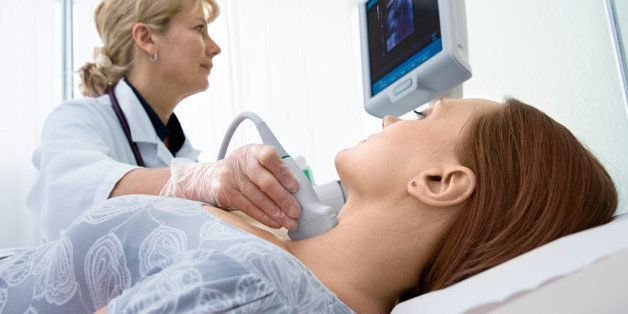 woman getting ultrasound of a...