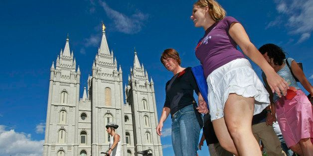 SALT LAKE CITY - JULY 12:  Protesters walk past the Mormon Temple on the Main Street Plaza holding hands July 12, 2009 in Sal