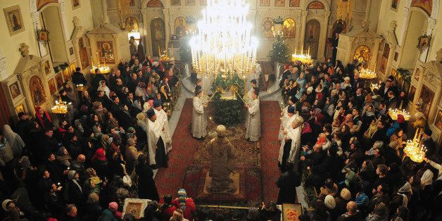 People attend a Christmas service in Baku early on January 7, 2014. Orthodox Christians celebrate Christmas on January 7 in t