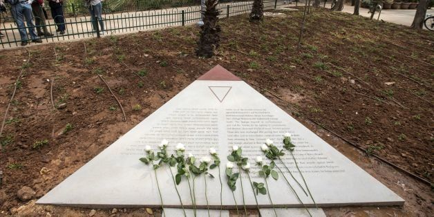 Flowers are laid at a memorial to thousands of gay Holocaust victims killed by the Nazi during the Second War at the Gan Meir