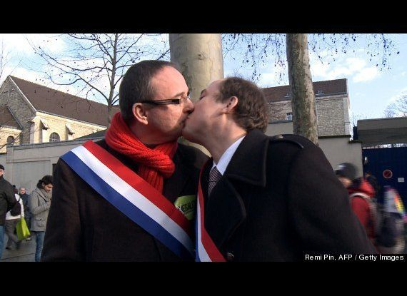 """French Parliament Members Yann Galut and Nicolas Bays share a """"Kiss of Solidarity"""" during demonstrations in Paris on Jan. 27,"""
