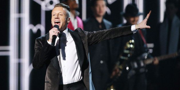 LOS ANGELES, CA - JANUARY 26:  Macklemore aka Ben Haggerty performs onstage during the 56th GRAMMY Awards held at Staples Cen