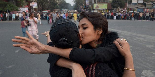 Indian gay rights activists participate in a protest against the Supreme Court ruling reinstating a ban on gay sex in Kolkata