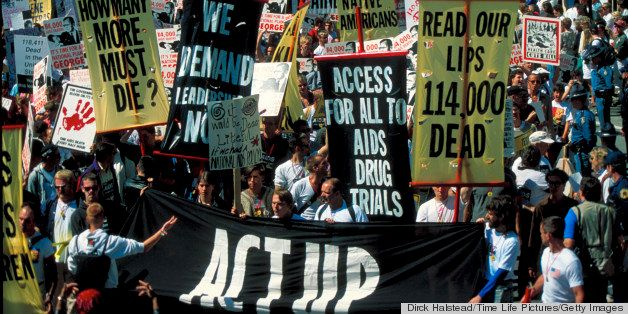 (Some 1500) gay advocates protesting Pres. Bush's AIDS policy in ACT UP demo, replete w. signs, in Bush vacation town, Kenneb