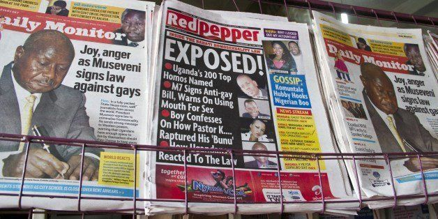 A picture taken on February 25, 2014 shows a newspaper stand with different types of Uganda's local dailies. On Monday, Presi
