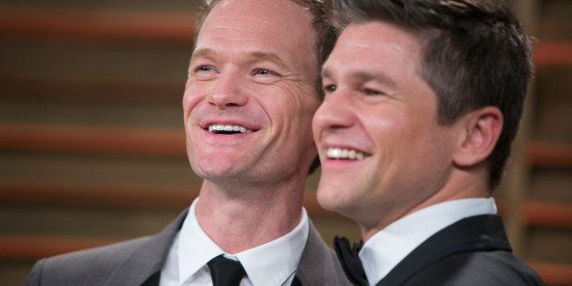 Neil Patrick Harris (L) and his spouse David Burtka arrive at the 2014 Vanity Fair Oscar Party on March 2, 2014 in West Holly