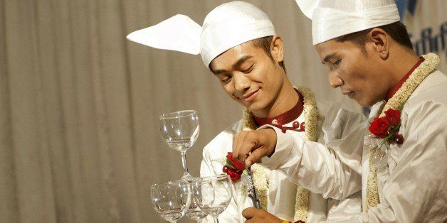 Tin Ko Ko (CR) and Myo Min Htet (CL) are celebrating the wedding reception at Yangon on March 2 , 2014. This is first ever Ga